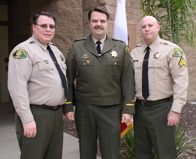 <p>Santa Barbara County Sheriff Bill Brown, center, congratulates newly named Custody Lt. Timothy McWilliams, left, and Custody Sgt. Richard Zepf at a promotions ceremony on Tuesday.</p>