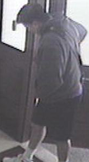 Surveillance photo of suspect in robbery of Bank of the West.