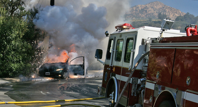 Flames rip through a minivan Monday on Santa Teresita Drive in Santa Barbara. A young girl was seriously burned in the incident, according to Santa Barbara police. (Santa Barbara County Fire Department photo)