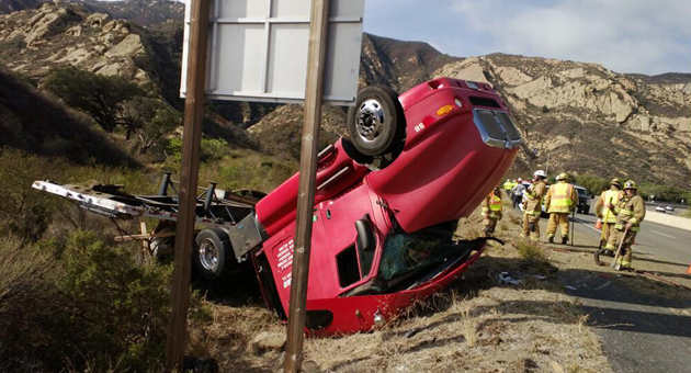 <p>A semi-tractor-trailer carrying a flatbed full of copper utility cables overturned Tuesday on Highway 101 about a quarter-mile north of the Gaviota State Beach turnoff.</p>