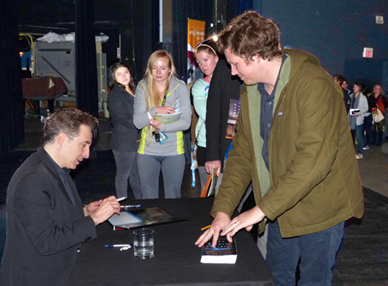 Physicist Brian Greene signs autographs Monday night after speaking at UCSB's Campbell Hall. (Robert Bernstein photo)