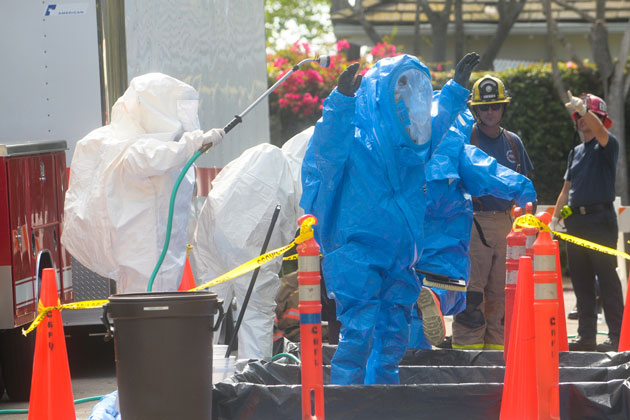 Firefighting crews practice decontamination during a hazardous materials drill Thursday in Montecito. Departments participated from Santa Barbara, Montecito and Carpinteria/Summerland, in addition to the Santa Barbara County Sheriff's Department bomb squad.