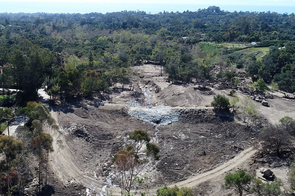 A photo taken from a drone on Monday shows the Cold Spring Debris Dam in Montecito completely cleaned out and ready for new storms. A weather system expected Thursday night into Friday has prompted county officials to issue an evacuation warning for communities below recent burn areas.