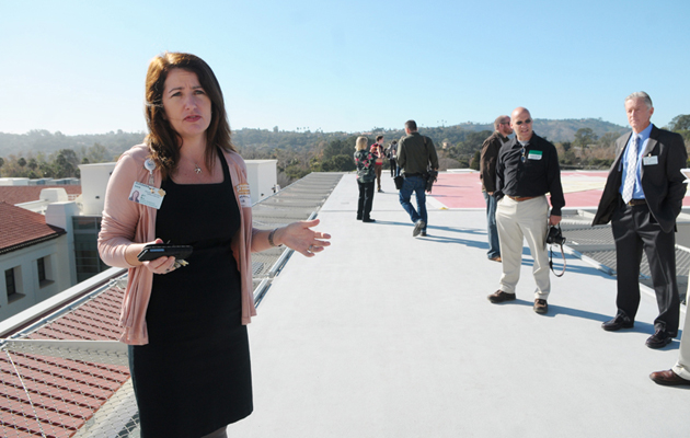 <p>Susanna Shaw, director of environment, safety and security for Santa Barbara Cottage Hospital, talks with the media near the helipad installed in January on top of the new facility. For the past month, the hospital has been responding to neighbors&#8217; complaints about noise from the helicopters.</p>