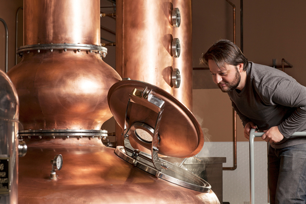 Steve Gertman inspects one of several copper containers in his Ascendant Spirits distillery in Buellton, which makes whiskey, vodka and more. (Ascendant Spirits Inc. photo)