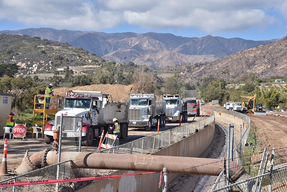 Trucks work to clear rocks and mud from the Santa Monica debris basin near Carpinteria Wednesday. It is the largest debris basin on the South Coast and all the rest have been emptied following the Jan. 9 debris flow, according to Rob Lewin, director of the Office of Emergency Management.