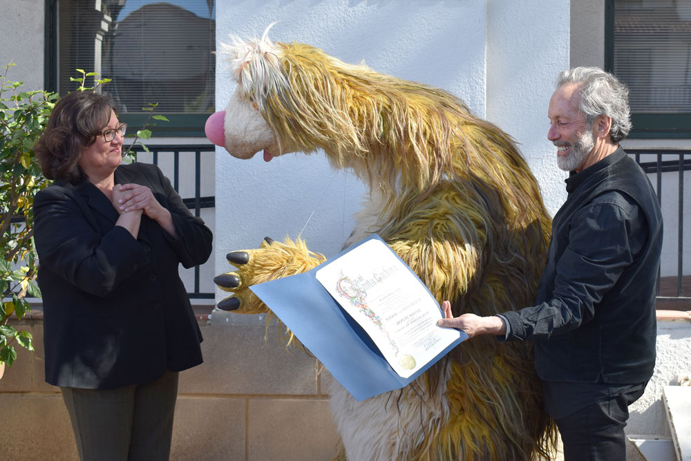 Santa Barbara Mayor Cathy Murillo presented a proclamation Wednesday naming 'Snook' the Eco Sloth deputy major in recognition of the 1st Santa Barbara International PuppetPalooza Festival, which runs from Thursday through Sunday. With her is festival director Mitchell Kriegman.