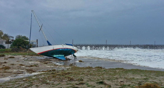A sailboat ended up on the sand Saturday at Goleta Beach County Park, which was evacuated and closed as a precaution due to high tides and surf. (Zack Warburg photo)