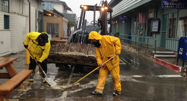 <p>Clean-up crews were kept busy at the Santa Barbara Harbor on Saturday as high tides and large surf caused minor flooding throughout the coastal areas.</p>