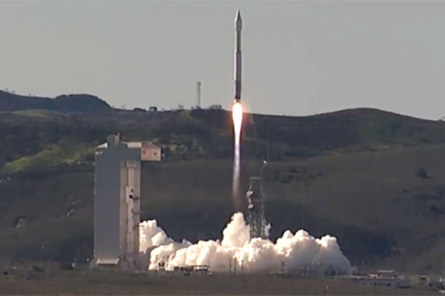 An Atlas V rocket roars off the launch pad at Vandenberg Air Force Base on Wednesday. The booster was carrying a secret payload for the National Reconnaissance Office.