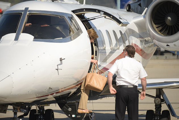 Former First Lady Laura Bush steps off a private jet Wednesday at the Santa Barbara Airport. She was scheduled to give the keynote speech later in the day to a conference of discount grocers at the Bacara Resort and Spa in Goleta.