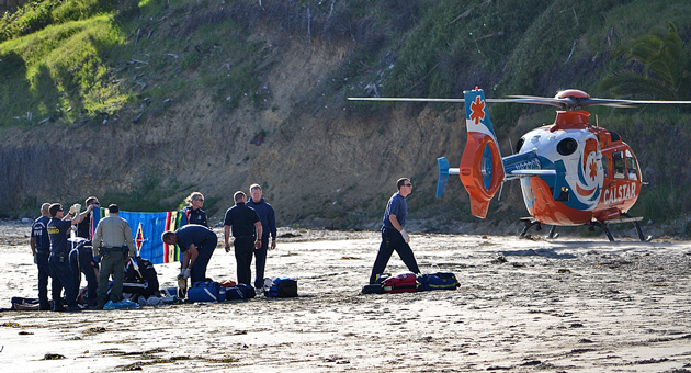 A CALSTAR helicopter stands by on Refugio State Beach while emergency personnel tend to a 58-year-old man who was pulled from the water not breathing and with no heartbeat. (Paul Dunkley photo / KEYT News)