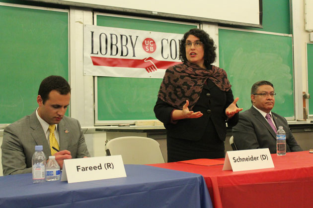 Santa Barbara Mayor Helene Schneider stands to make a point during a Thursday night debate among candidates for the 24th District seat in Congress.
