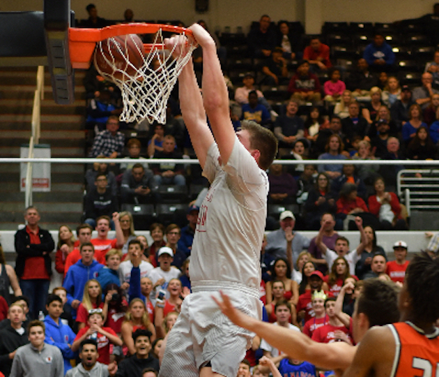 San Marcos center Jackson Stormo dunks two of his 17 points in the CIF 2A Division championship victory over Riverside Poly.
