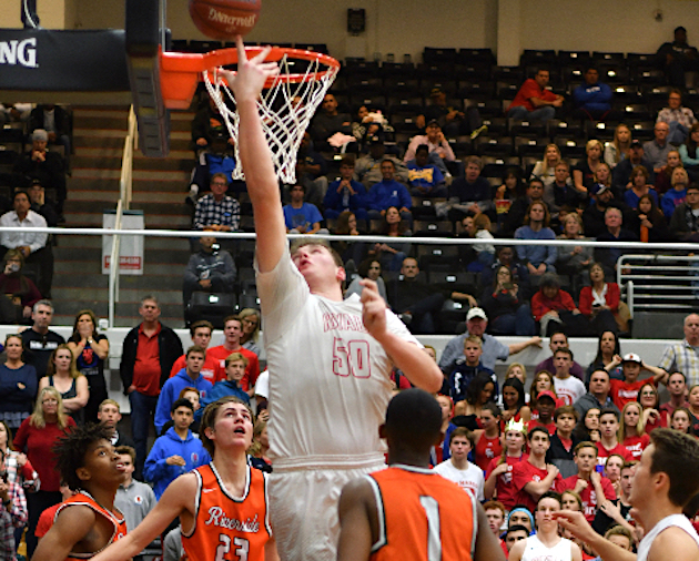 Jackson Stormo completes a reverse layup during the fourth quarter. The Royals outscored Riverside Poly 41-28 in the seond half.