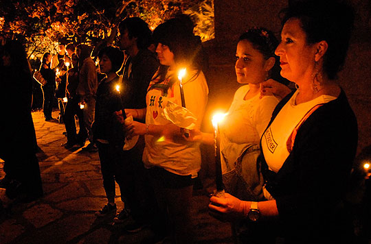 From right, Susi Cassar, Penelope Romero and Cyndy Vargas listen to a prayer during a candlelight vigil at the Santa Barbara County Courthouse on Wednesday. The vigil was a rally against Proposition 8, the ballot measure banning same-sex marriage that will be considered at the state Supreme Court on Thursday.
