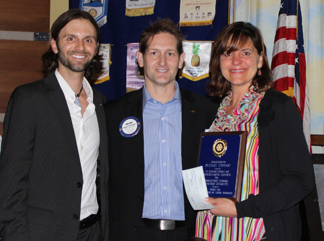 <p>Rotary Club of Santa Barbara members Chris Clemens, left, and Roland Christopher with award recipient and Roosevelt Elementary first-grade teacher Alison Throop.</p>