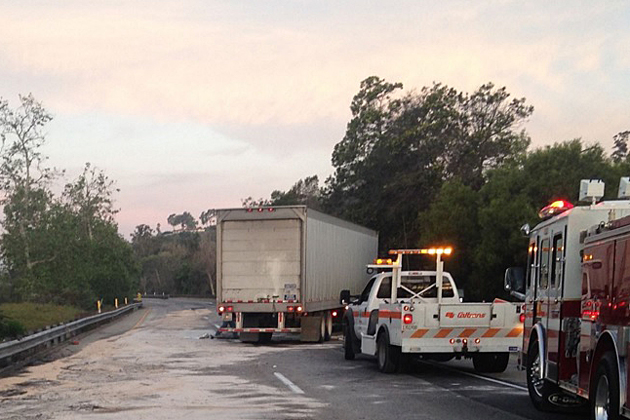 A Santa Barbara Fire Department hazmat team responded to the scene of a diesel fuel spill on Highway 101 on Friday morning after a big-rig crashed into a guardrail.