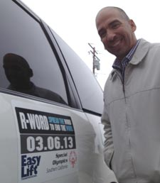 Executive Director Ernesto Paredes shows an Easy Lift Transportation vehicle that's raising awareness for the