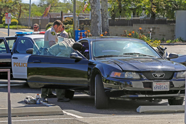 Sheriff's deputies search a 2001 Ford Mustang that was involved in a high-speed chase Sunday through the streets of Golea. The driver, Marcos Berrera, 39, of Goleta, was arrested on multiple felony charges.