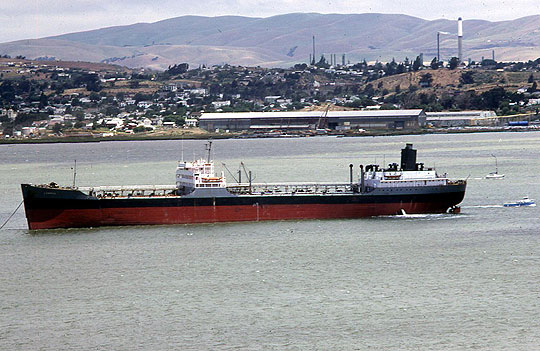 The SS Lompoc lies at anchor in the East Bay in an undated file photo. In 1952, the Lompoc was damaged in a deadly fire that started on and sank a tanker docked nearby.