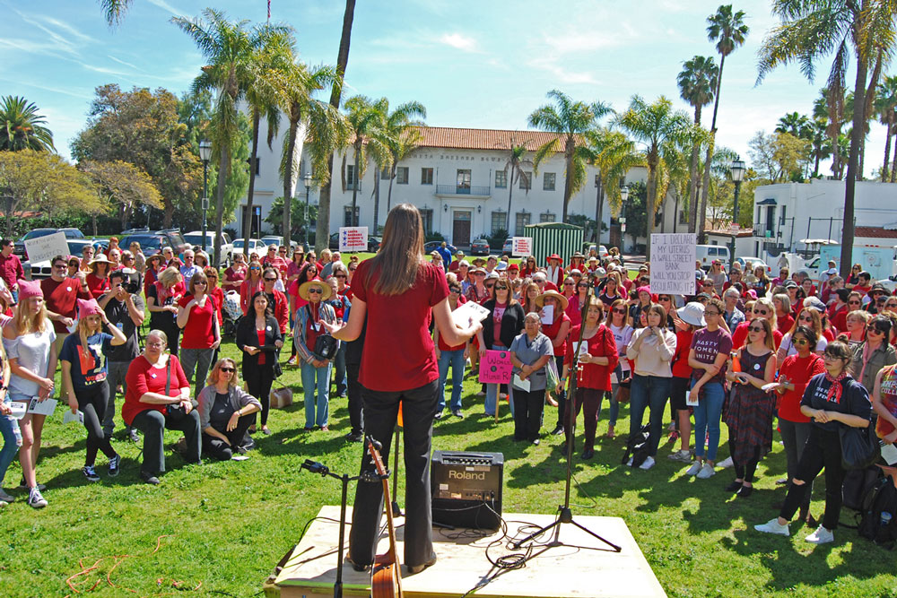 More than 250 community members gathered on the grass in De la Guerra Plaza in downtown Santa Barbara on Wednesday to mark International Women's Day.