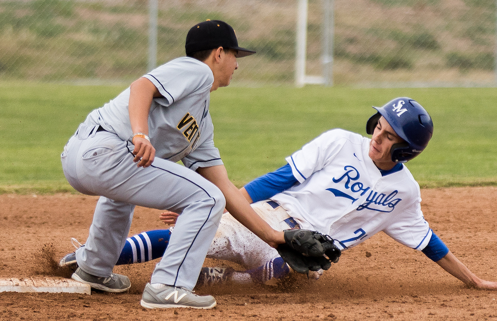 Vince Vogel of San Marcos slides safely into second place against Ventura.
