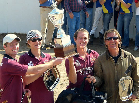 The Westmont College polo team — from left, Collin White, Wiley Uretz, Bodie Bottoms and coach John Westley — were all smiles while hoisting the hardware after their regional tournament victory.
