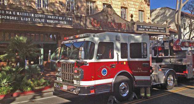 <p>A Fire Department ladder truck is staged outside the Granada building in downtown Santa Barbara Wednesday afternoon after a fire-sprinkler mishap caused flooding in the building.</p>