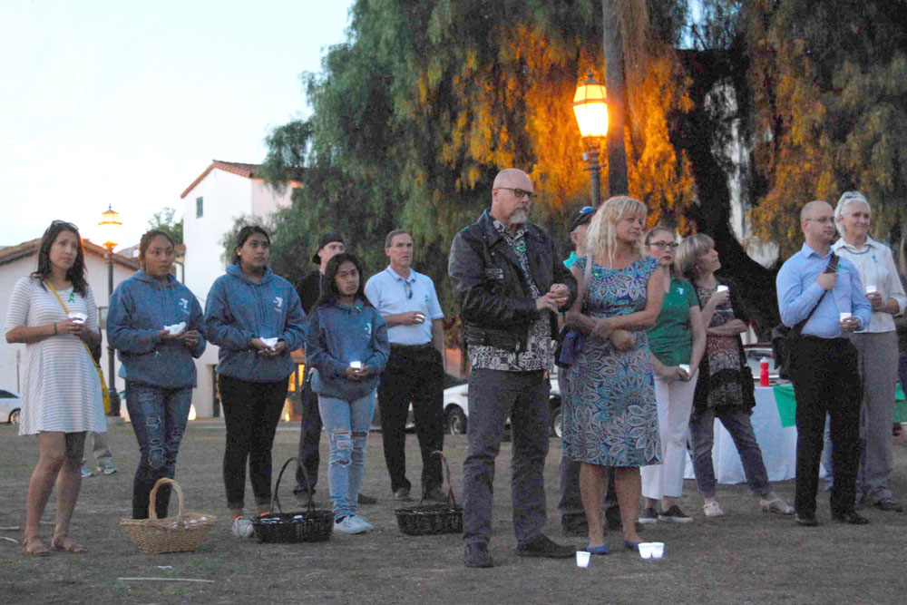 A crowd of more than 50 supporters held a candlelight vigil to raise awareness about homeless and runaway youth on Thursday night in De la Guerra Plaza in Santa Barbara.