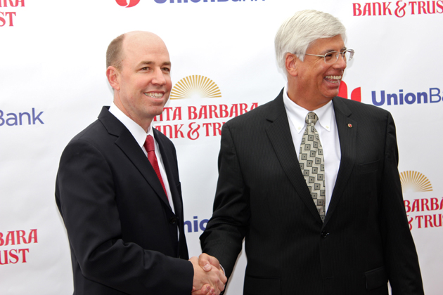 Union Bank Vice Chairman Tim Wennes, left, and Pacific Capital President George Leis attend Monday's news conference at Santa Barbara Bank & Trust announcing the banks' $1.51 billion merger.
