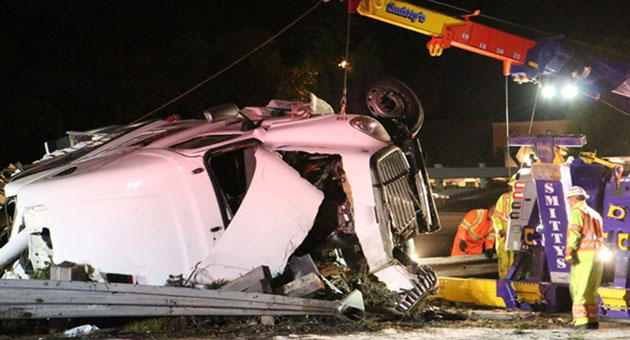 <p>Workers clear the wreckage of a Freightliner big-rig that crashed Wednesday night on Highway 101 in Carpinteria, tying up traffic overnight.</p>