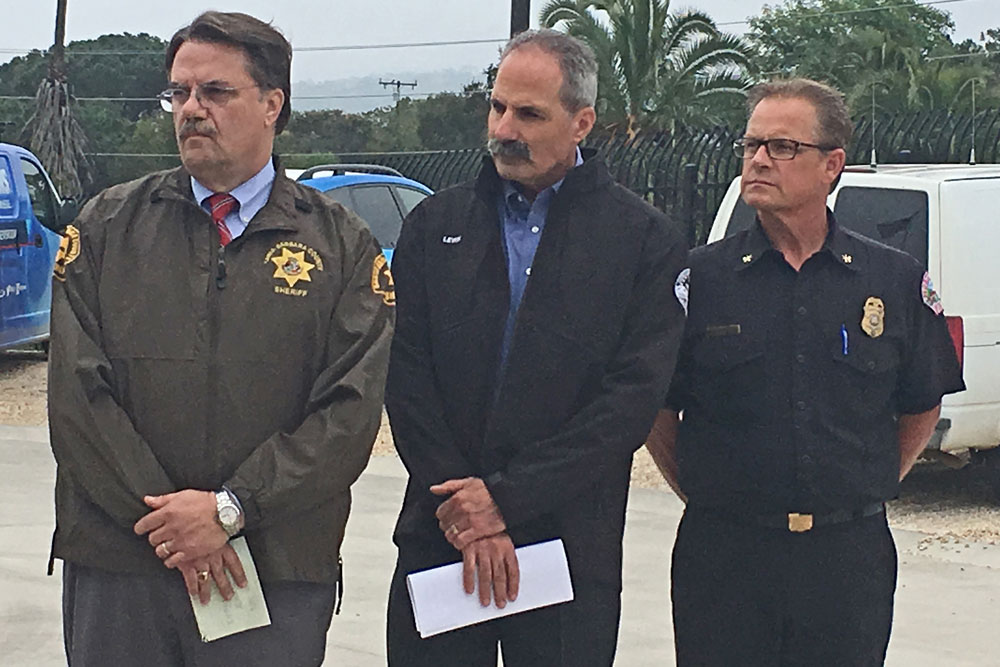 Emergency officials in Santa Barbara County held a press conference Monday — ahead of a Tuesday storm — to announce mandatory evacuation orders for communities below the Thomas, Whittier, Alamo and Sherpa fire burn areas. Above, from left, are Sheriff Bill Brown, Rob Lewin, director of the county's Office of Emergency Management, and Kevin Taylor, assistant chief of the Montecito Fire Protection District.