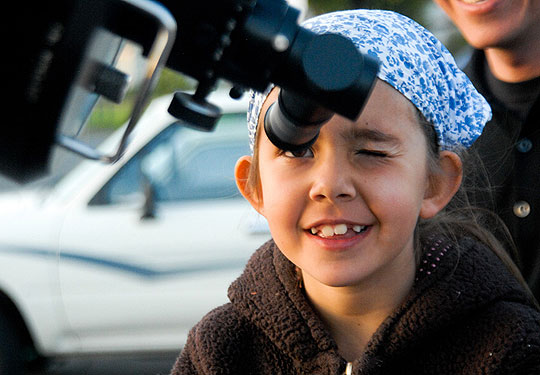 Camille Lubach, 7, checks out Venus through a telescope in the parking lot at Hollister School's Science Night.