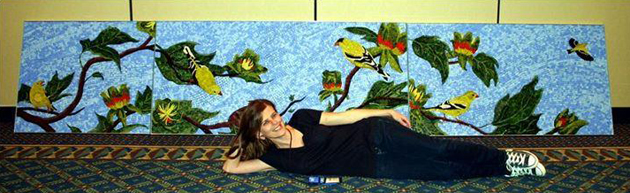 Local mosaic artist Christine Brallier poses with the completed
