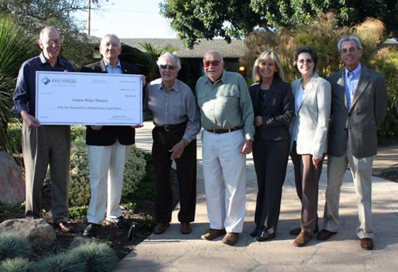 Goleta Water District board members accept a $56,000 refund from ACWA/JPIA Executive Committee members. Pictured, left to right, are GWD board president Bill Rosen, ACWA/JPIA Executive Committee member David Hodgin, district board member Jack Cunningham, district board member Bert Bertrando, ACWA/JPIA Executive Committee member Melody McDonald, district board vice president Lauren Hanson and district board member Rick Merrifield. (Goleta Water District photo)