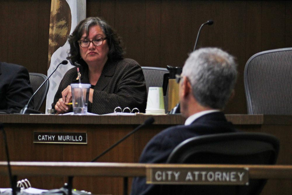 City Councilwoman Cathy Murillo, who has repeatedly voiced concerns over the impacts an oversized vehicle parking ban will have on RV dwellers, discusses exemption permits with City Attorney Ariel Calonne at Tuesday's meeting.
