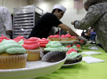 Students in SBCC's culinary arts program serve cupcakes and other treats during Friday's fundraising event. (Gabriella Slabiak / Noozhawk photo)