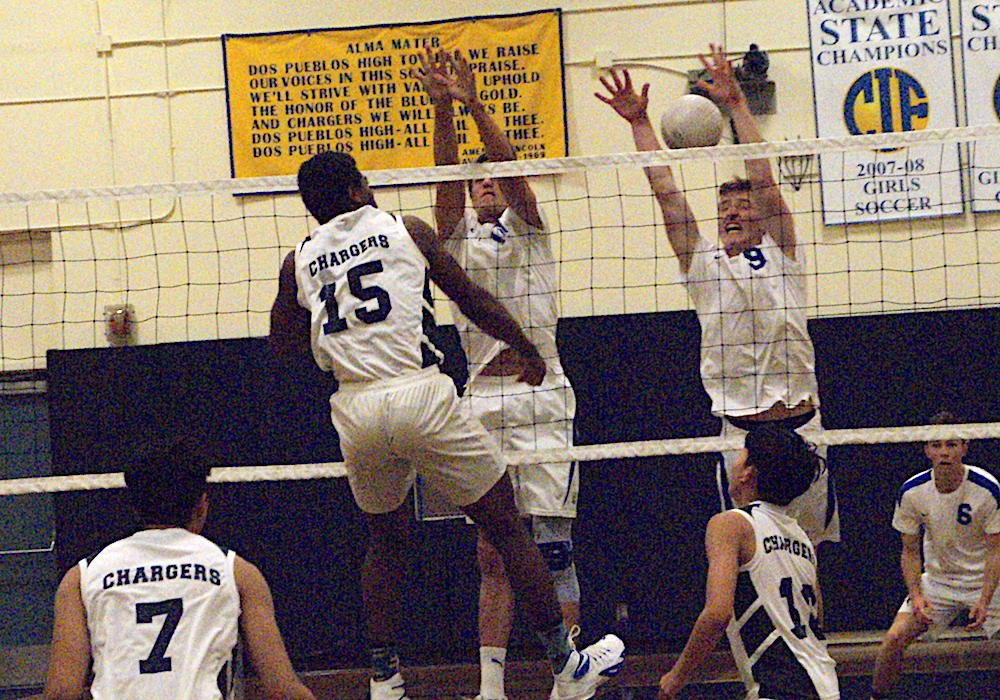 Marcellous Gossett of Dos Pueblos hits through the block of Parker Bittner, left, and Ryan Fay of San Marcos. Gossett had 11 kills.