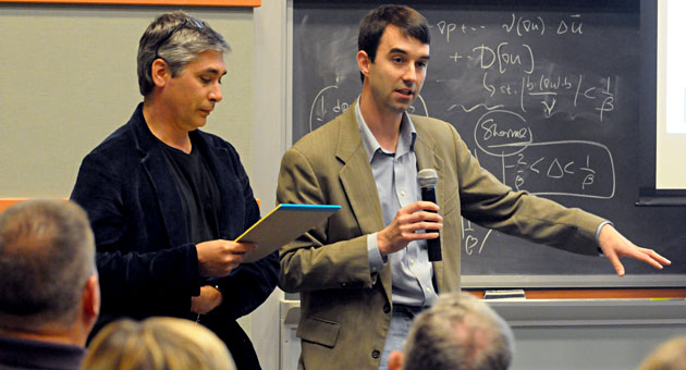 UCSB professors Patrick McCray, left, and Ben Monreal speak to the audience during Wednesday's lecture in Kohn Hall on the nuclear events in Japan and their implications.