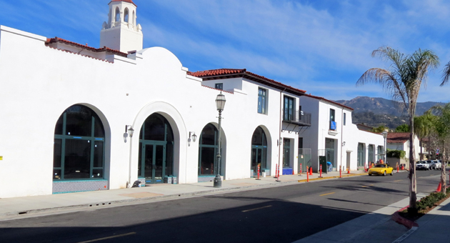 <p>Crews work to finish landscaping and other touches on the Alma del Pueblo development in downtown Santa Barbara, which is slated to open sometime in April.</p>