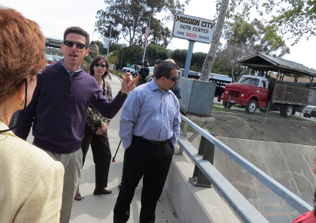 <p>Towbes Group president Craig Zimmerman, left, explains the progress being made on the San Jose Creek Capacity Improvement and Fish Passage Project while standing on the Hollister Avenue Bridge in Goleta. Zimmerman helped lead a Wednesday tour of Goleta Valley Chamber of Commerce board members through developments in the area.</p>