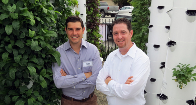Montecito Urban Farms owner Alex Thomson, left, first learned about the tower garden concept through Tim Blank, founder of Florida-based Future Growing LLC. Thomson hosted a grand opening for the vertical greens garden Wednesday. (Gina Potthoff / Noozhawk photo){