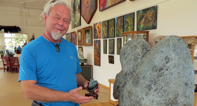 <p>JadeNow Gallery owner Jeff &#8220;Jade&#8221; Spangler poses with some of his signature jade pieces inside his new art gallery at 14 Parker Way in downtown Santa Barbara.</p>