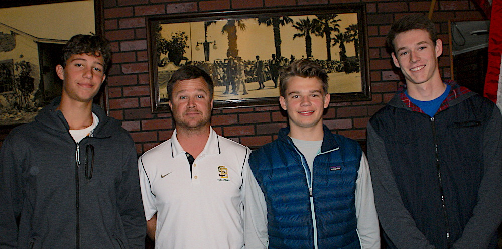 Santa Barbara High boys volleyball coach Chad Arneson, second from left, is joined by players Will Rottman, left, Dane Westwick and Henry Hancock.