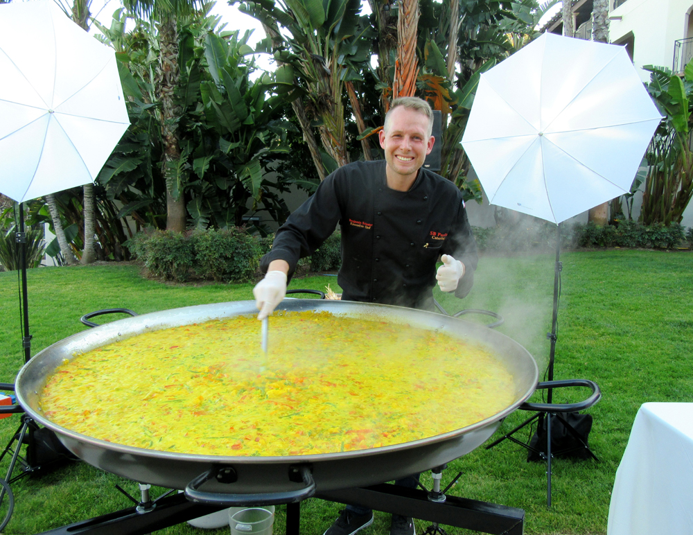 A giant cauldron of paella is cooked up by Benjamin and Carol Schuster of Santa Barbara Paella for early evening hors d'oeuvres.