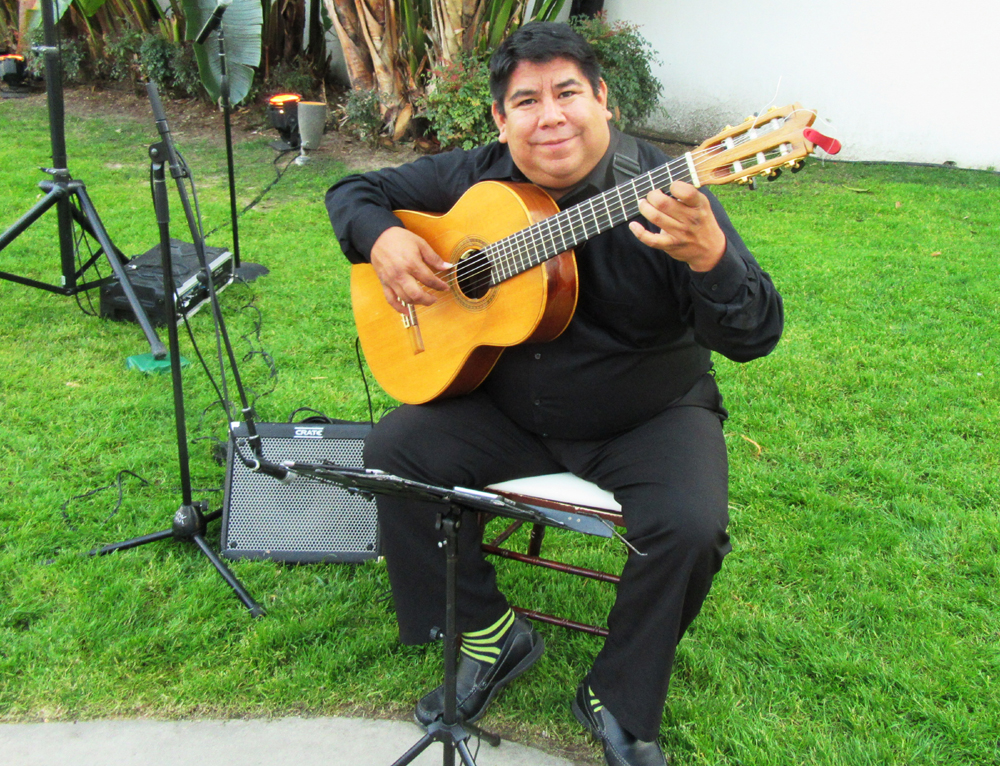 Master guitarist Tony Ybarra performs at the reception.