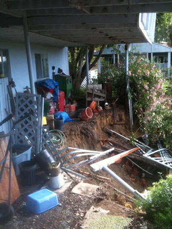 A landslide threatened a home Monday on North San Marcos Pass. The residents weren't home at the time, and no one was injured.