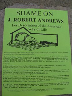 Fliers handed out by banner holders feature a picture of a rat chewing on a U.S. flag.
