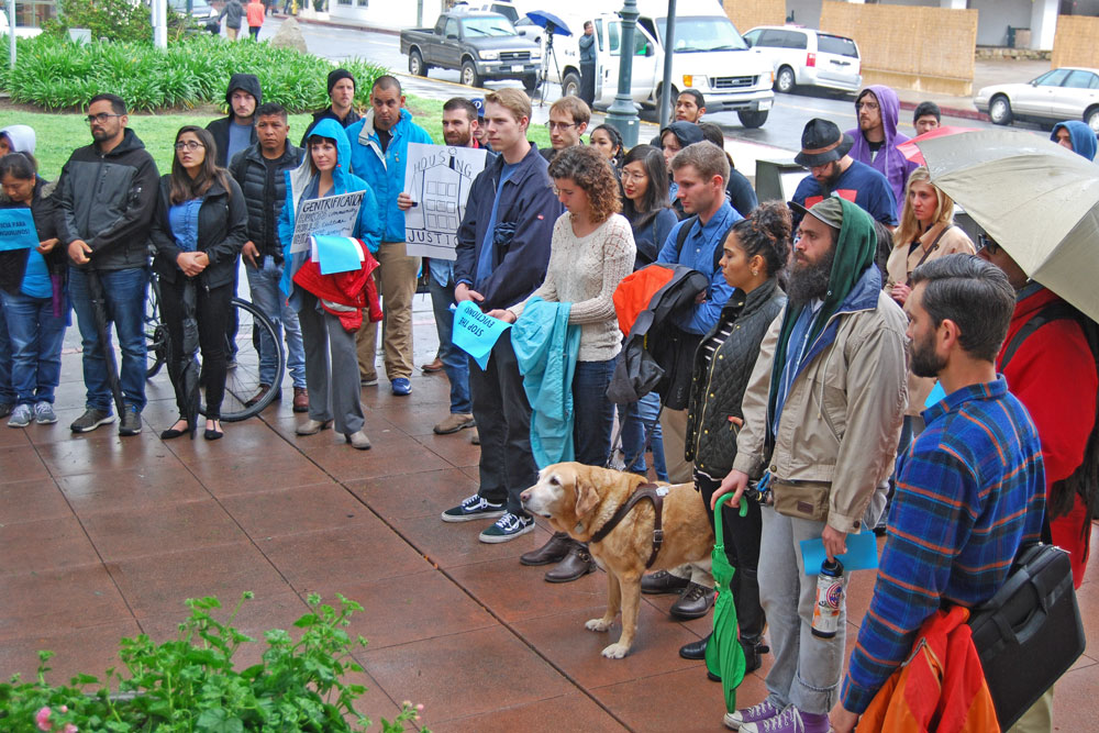 Wearing blue to show support for renters' rights, more than 50 tenants and advocates gathered before Tuesday's Santa Barbara City Council meeting to call for regulations protecting working-class immigrant residents from being forced out by rising rents.